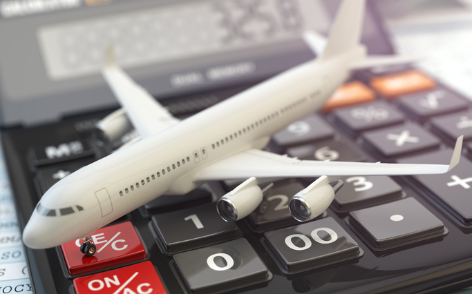 Calculating corporate travel costs - airplane on calculator