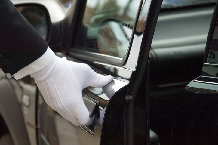Private limo driver opening door