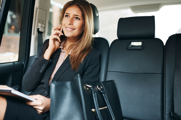 Corporare travel woman in private car