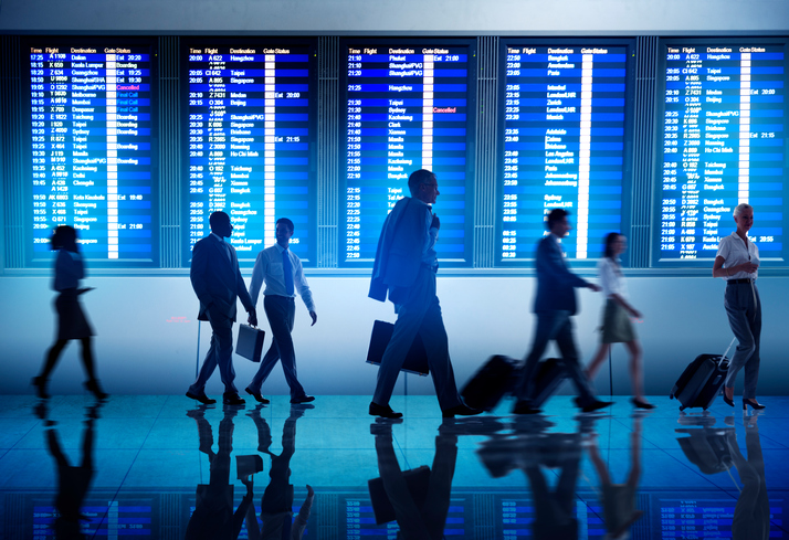 Corporate travellers walking in busy airport