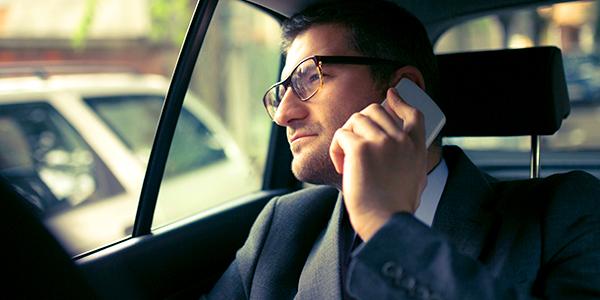 Car Service CT - Businessman on a call