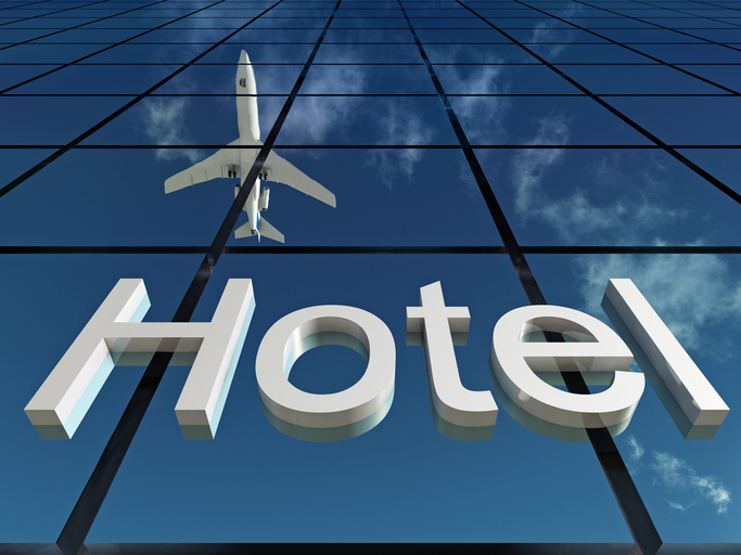 Laguardia hotel sign with plane above