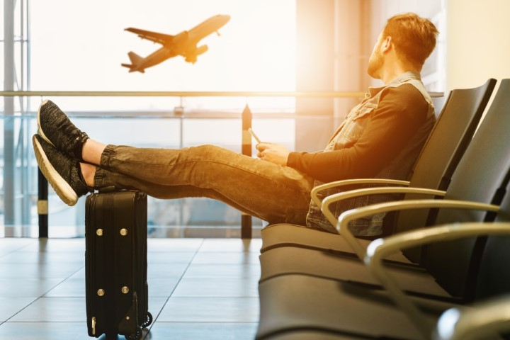 Man sitting in airport awaiting travel