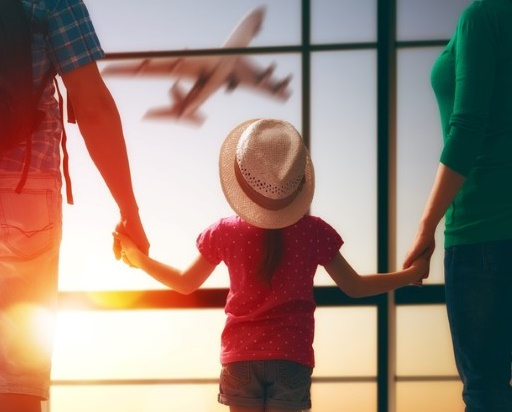 Family travelling to the airport with children